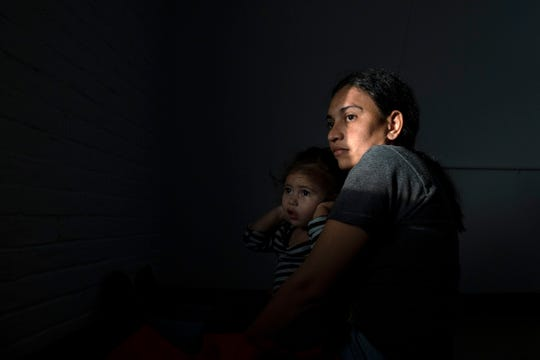 A mother and child, refugees from Central America, at the Humanitarian Respite Center in McAllen, Texas.