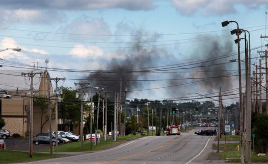 Aug. 2010: Police closed off Scottsville Road behind the airport as hydrogen tanks that exploded on Scottsville Road at the Monroe County fueling station continued to burn.