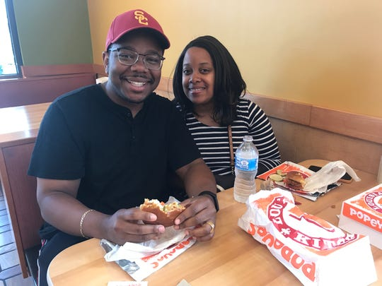 Rayvon and Brittany Moore of Rochester are fans of the spicy chicken sandwich at Popeyes.