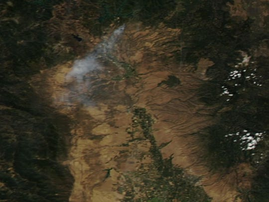 Smoke from the Mountain Fire was captured by NASA's Earth Observing System Data and Information System (EOSDIS) on August 22, 2019.