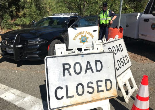 A roadblock remained in place Friday morning, Aug. 23, 2019, at the intersection of Bear Mountain and Dry Creek roads due to the Mountain Fire in Jones Valley.