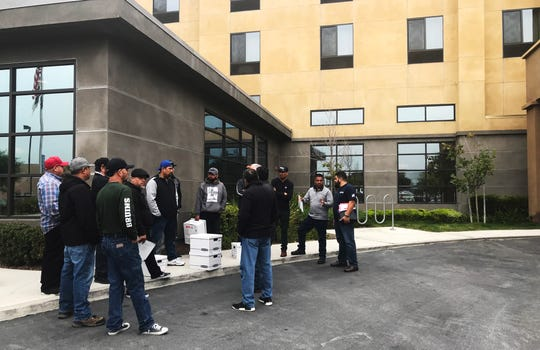 Pete Maturino, the Agricultural Division Director of UFCW Local 5, meets with the recently-fired workers from Fresh Express outside a hotel Friday morning. Aug. 23, 2019.