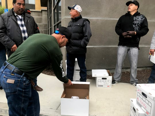Workers fired by Fresh Express Friday sift through boxes of their belongings that they had left in their lockers earlier in the week. August 23, 2019.