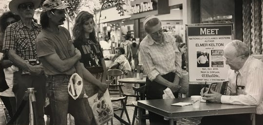 """San Angelo author Elmer Kelton signs copies of his latest book, """"Slaughter,"""" at the B. Dalton bookshop in Sunset Mall back in October of 1982."""
