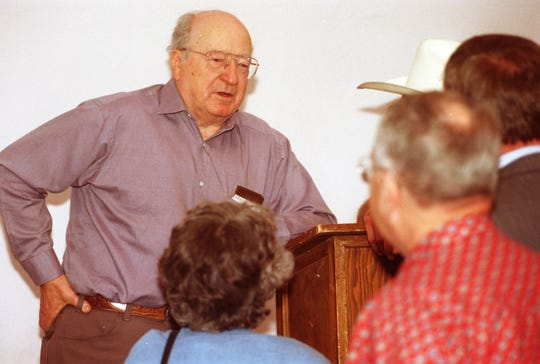 Western novelist Elmer Kelton talks with fans during the Spring Speakers Series at Historic Fort Concho in San Angelo in April 1998.