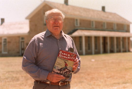"""Acclaimed Western novelist and news writer Elmer Kelton is photographed at Fort Concho in San Angelo holding a copy of """"Ranch Romances"""" Magazine, where he published his first fiction story for $50 in 1947."""