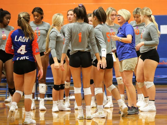 San Angelo Central High School head volleyball coach Connie Bozarth talks strategy with the Lady Cats earlier in the 2019 season.