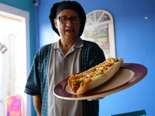 Doggie Style owner Javier Quereguan makes gourmet foot longs at his new shop in Rehoboth Beach. Thursday, Aug. 22, 2019.