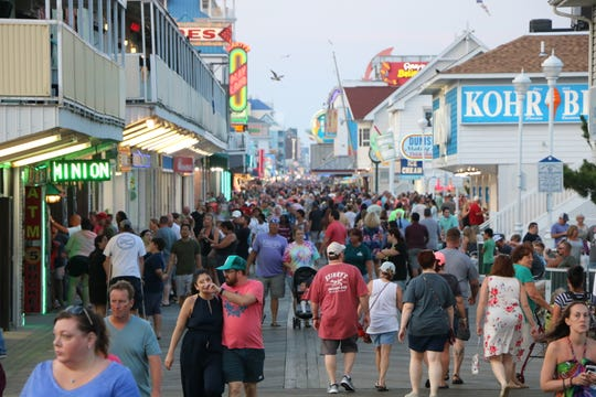 Crowds walk along the Ocean City boardwalk near the Ocean City Life-Saving Station Museum on Aug. 22, 2019. Business owners say late August is one of the busiest times for tourism in Ocean City.