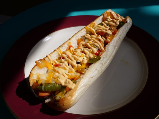 Peppers, onions, chipotle mayo, jalapenos and cheese are a few of the foot long toppings you can get Doggie Style in Rehoboth Beach. Thursday, Aug. 22, 2019.