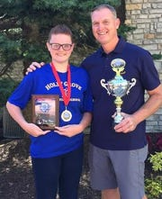 Holly Grove archery coach Bruce Bowden poses with Samantha Porter after she placed third overall in the girls middle school division.
