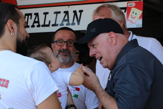 Maryland Governor Larry Hogan meets a baby at Piezano's Pizza & Italian Restaurant in Ocean City on Aug. 16, 2019. Hogan was meeting with Ocean City business owners and thanking them for their work.