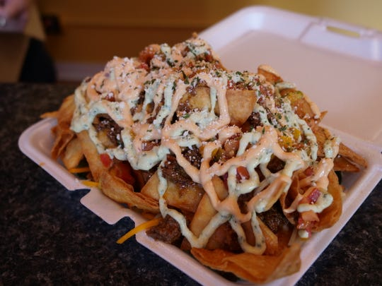 The nachos at Doggie Style in Rehoboth Beach are made to order, right down to the chipotle crema and home-fried tortilla chips. A massive, delicious feat. Thursday, Aug. 22, 2019.