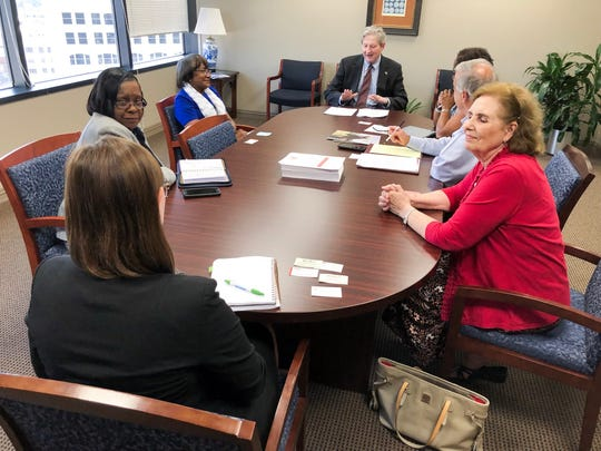 Louisiana Sen. John N. Kennedy meets with multiple people affiliated with AARP on Thursday at the American Tower in downtown Shreveport.