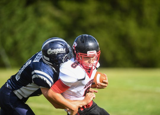 Lyman High School quarterback Teagan Gourneau (8) runs the ball at Tolstedt field, Friday, Aug. 23.