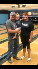 Jordan Schmidt (left) and Steph Bittner (right) with their three-year old daughter, Korbyn, at the new Pinz bowling alley in Dell Rapids.