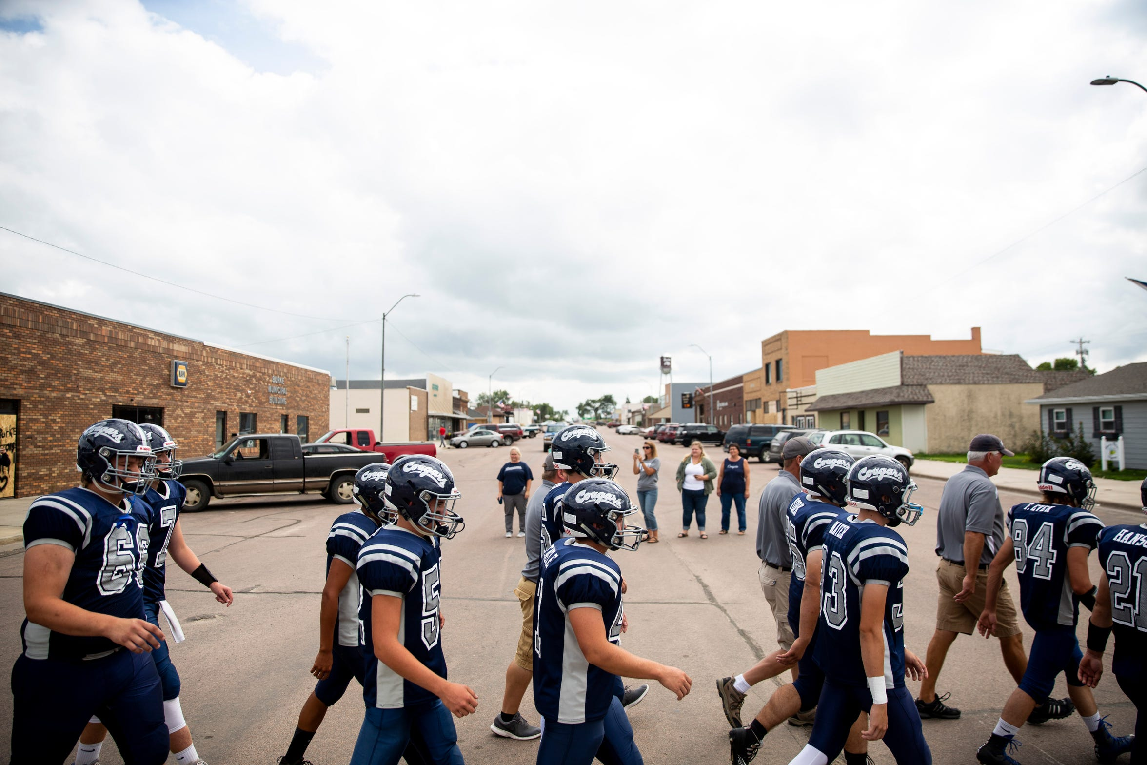 Burke High School football team walks to Tolstedt field, Friday, Aug. 23.