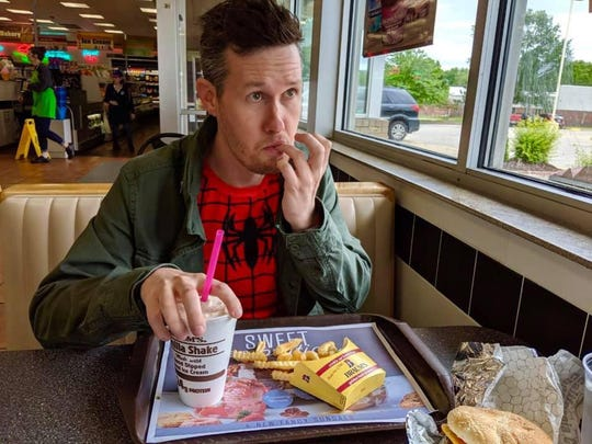 Michael Underlin, pictured here as Spiderman enjoying some French fries, was voted the fourth Captain Springfield.