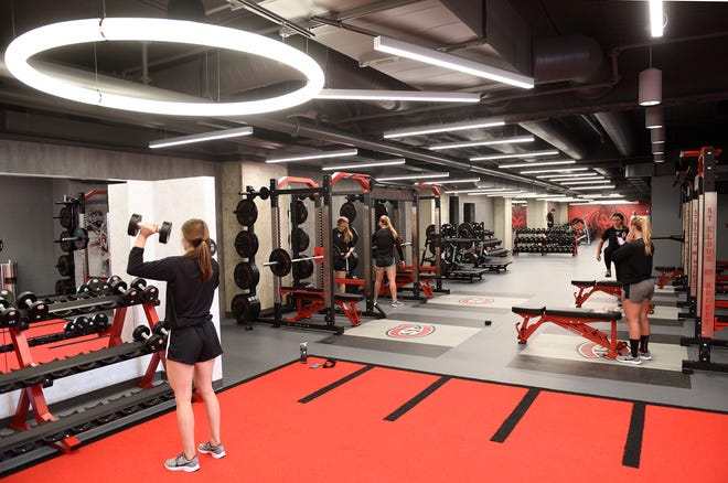 Members of the SCSU women's hockey team work out in the new weight room for the men's and women's programs Friday, Aug. 23, 2019, at Herb Brooks National Hockey Center. The facility was completed last week and is located right behind the men's and women's locker rooms.