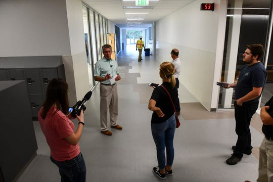Principal Charlie Eisenreich talks about details of the building during a tour of the new Tech High School Thursday, Aug. 22, in St. Cloud.
