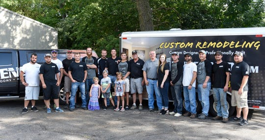 Lutgen Companies, a construction and remodeling company, has employees pose for a photo Thursday, Aug. 22, 2019 in Waite Park.