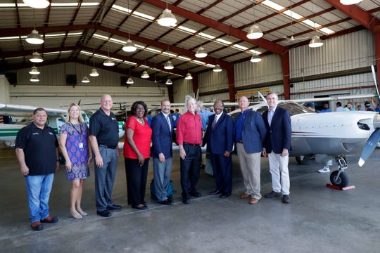 Elected officials, Lively Technical College representatives, a and Dr. Jesse Judelle pose for a photo in front of the plane donated by Judelle and his wife Elise Judelle.