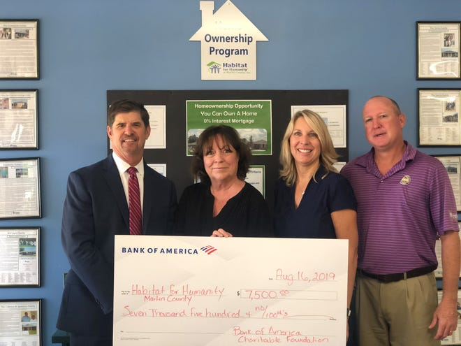 Bank of America recently presented Habitat for Humanity of Martin County with $7,500 to support the organization's home building initiatives. (L-R: Doug Sherman, Bank of America Treasure Coast Market President; Margot Graff, Habitat for Humanity of Martin County Executive Director; Tammy Matthew, Bank of America Treasure Coast Market Manager; Mike Readling, Habitat for Humanity of Martin County Director of Resource Development & Donor Relations