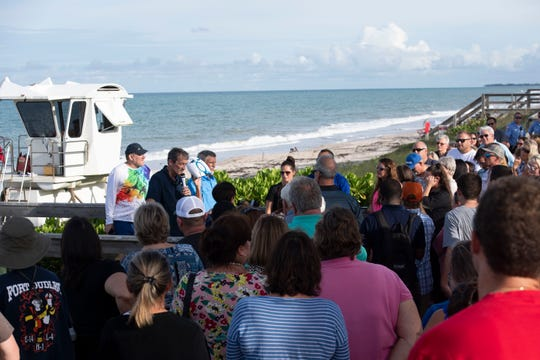 "One week after missing firefighters Brian McCluney, a Cocoa native, and Justin Walker, a Vero Beach native, set off on a boating trip in the ocean, a couple hundred Indian River County locals join together for a prayer vigil, led by Pastor Dave Foster (second from left) on Friday, Aug. 23, 2019, at Jaycee Park in Vero Beach. ""It's overwhelming, but it gives my heart peace. It gives me confidence. We're not done,"" said Sheila Walker, of Vero Beach, mother of Justin Walker, of the community support. The U.S. Coast Guard suspended the search for the men Thursday after looking for them over 105,000 square miles and nearly 250 hours of searching, but Walker's father continued to search using a private plane."