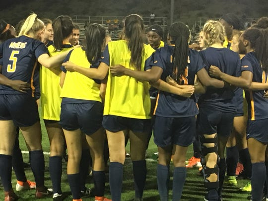 The UTEP women's soccer team huddles up prior to its overtime tie against Wyoming on Thursday night, Aug. 22, 2019, at University Field.