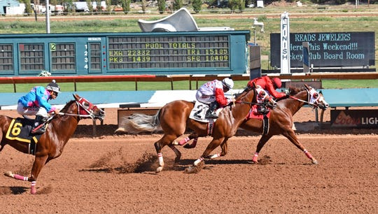 Mister Riptide, in front, along with second place finisher My Fast Prize qualified for this year's All American Futurity at Ruidoso Downs Racetrack and Casino.