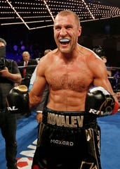 Sergey Kovalev celebrates after defeating Igor Mikhalkin in the seventh round of a WBO light heavyweight title boxing match on March 3, 2018, in New York.