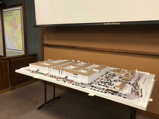 This model of the proposed apartment project at Fisherman's Wharf was produced by a group opposing it and shown at a planning panel's hearing Thursday. The 400 apartments are shown at left beside the existing commercial buildings, which are proposed for redevelopment with new and refurbished structures.