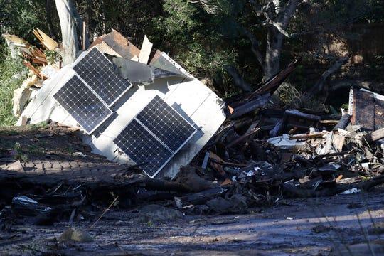 In this Jan. 10, 2018, file photo solar panels from a destroyed home and debris are shown in Montecito after the Thomas Fire.