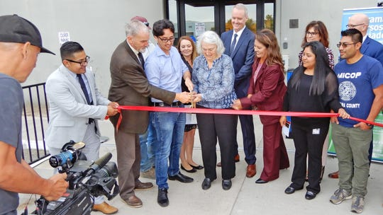 Participating in the Farmworker Resource Program ribbon cutting in Oxnard are, from left: Israel Vásquez, county Supervisor Steve Bennett, Lukas Zucker, Tracey Gallaher, Ellen Brokaw,  County Executive Officer Mike Powers, Talia Barrera, Fatima Peña, Melissa Livingston, Barry Zimmerman and Juvenal Solano.