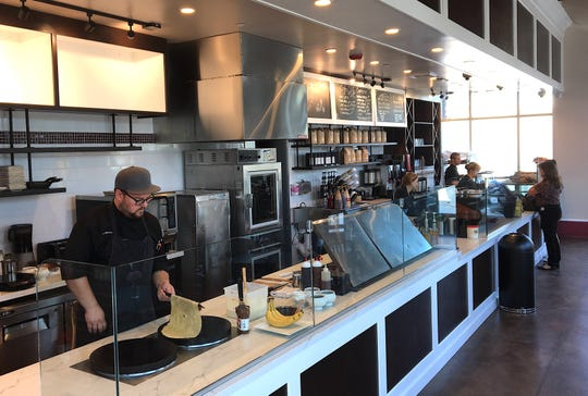 Jake Bernard, left, prepares to flip a crepe at Café Ficelle in Camarillo. The French-style bakery and cafe launched soft-opening hours on Aug. 21.