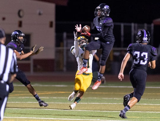 Mission Oak's Darren See intercepts a pass intended West Bakersfield's Xavier Loopez in a pre-league high school football game at Mathias Stadium on Thursday, August 22, 2019.