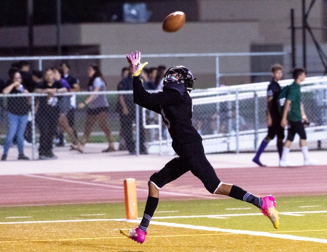 Mission Oak's Victor Gomez takes a pass to score against West of Bakersfield in a pre-league high school football game at Mathias Stadium on Thursday, August 22, 2019.