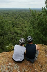 Cyclists Theresa and Jim Hagen of Colby sit on a sandstone outcropping and enjoy one of the many scenic views at the Levis Mound Recreational Area in southwestern Clark County, Saturday, August 29, 2015.