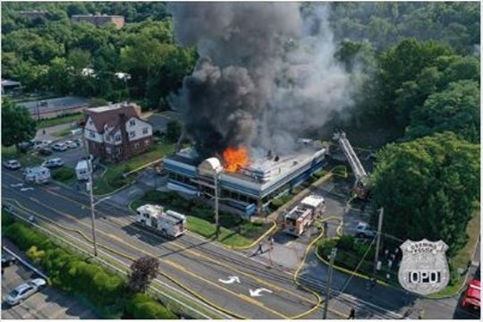 Fire burns at the Landmark Diner on Route 9 in Briarcliff Manor on Thursday, Aug. 22, 2019. It is seen in this aerial drone photo taken by the Ossining Police Department. The diner is on the Briarcliff-Ossining border.