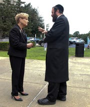 "New York State Assemblywoman Ellen Jaffee chats with opposition Rockland County Legislator Aron Wieder after a press conference where she urged the public to comment to NY State Education department in support of new ""substantial equivalency"" regulations that will ensure every child in Hasidic and ultra-Orthodox yeshivas receives the education they are entitled under state law in New City Aug. 23, 2019."