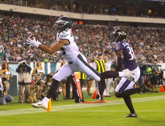 Eagles receiver J.J. Arcega-Whiteside snags a touchdown pass in the third quarter as Baltimore's Stanley Jean-Baptiste in preseason action at Lincoln Financial Field Thursday.