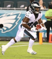 Eagles running back Boston Scott takes a kick in the second quarter in preseason action at Lincoln Financial Field Thursday.