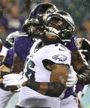 Eagles defensive end Shareef Miller nearly loses his helmet as he rushes the quarterback in the fourth quarter in preseason action at Lincoln Financial Field Thursday.