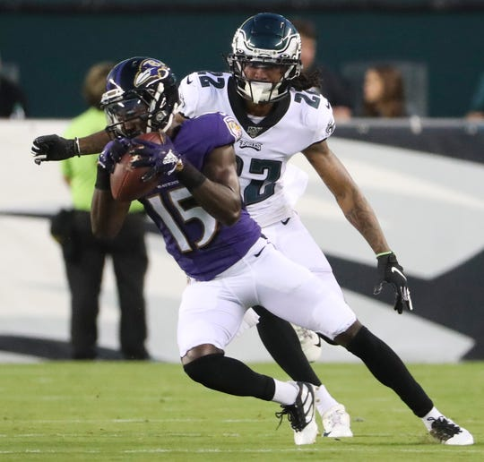 Baltimore receiver Marquise Brown (15) makes a catch in front of Eagles cornerback Sidney Jones in the first quarter in preseason action at Lincoln Financial Field Thursday, Aug. 22.