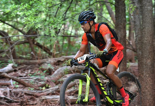 Houston's Armando Espinoza breezes through the tree during the Hotter 'N Hell Hundred Off-Road races Friday on the Wee-Chi-Tah Trail.
