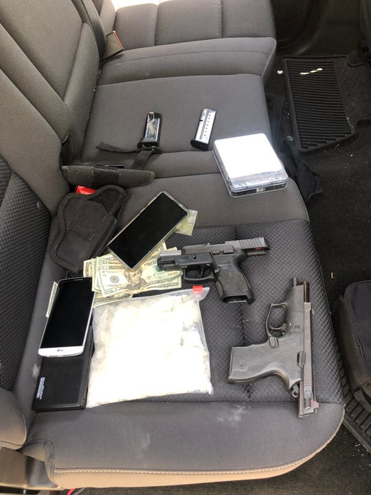 Investigators with the Wichita County District Attorney's Office found two loaded guns, a pound of methamphetamine and other items shown here in the vehicle of a man and a woman arrested on drug charges and unlawful possession of a handgun by a felon charges. Acting on a tip from a confidential informant, investigators arrested a man and a woman Wednesday in Wichita Falls.