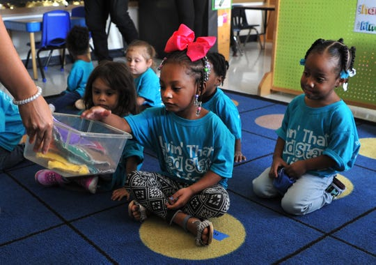 Farris Head Start student, 3-year-old E'moni Byrd, centered sports her new Welcome Back to School t-shirt Friday morning.
