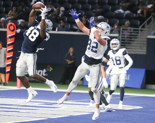 Dallas Cowboys linebacker Joe Thomas (48) intercepts a pass intended for Jason Witten (82) during NFL football practice, Wednesday, Aug. 21, 2019 in Frisco, Texas. (Shaban Athuman/The Dallas Morning News via AP)