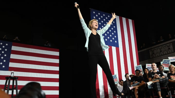 Democratic presidential candidate Sen. Elizabeth Warren, D-Mass., raises her arms at the conclusion of a Los Angeles Town Hall at the Shrine Auditorium and  Expo Hall in Los Angeles on Wednesday Aug. 21, 2019.
