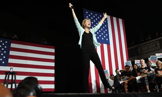 Democratic presidential candidate Sen. Elizabeth Warren, D-Mass., raises her arms at the end of a town hall at the Shrine Auditorium and Expo Hall in Los Angeles on Aug. 21, 2019.